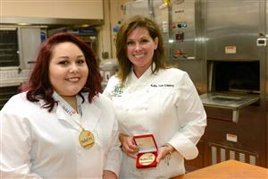 Chef Puff posing with SkillsUSA State Champion, Jordan Baker