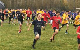 middle school athletes running