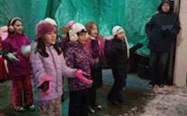 primary chorus singing at holiday event