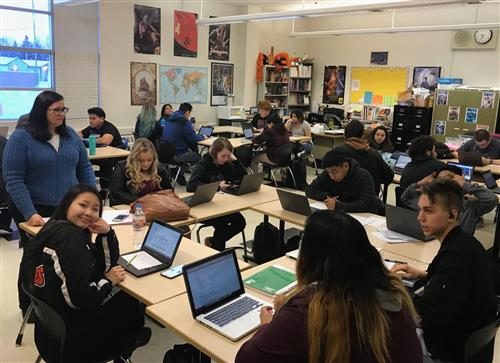 students work on chromebooks in a West High English classroom