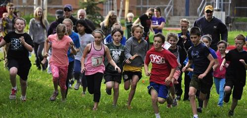 Students running in Fun Run Slider