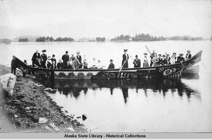 historical photo of people on a large canoe