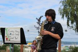 Student playing sax at Saturday market