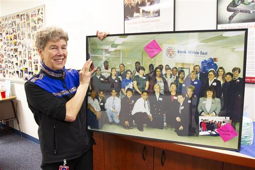 Bank Within East advisor Trudy Keller with a picture from when the bank opened.