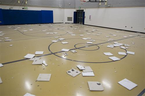 Ceiling tiles on the floor of the gym at Eagle River Elementary