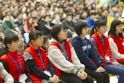 Exchange students from Chitose, Japan take part in the welcome assembly at Mears Middle School