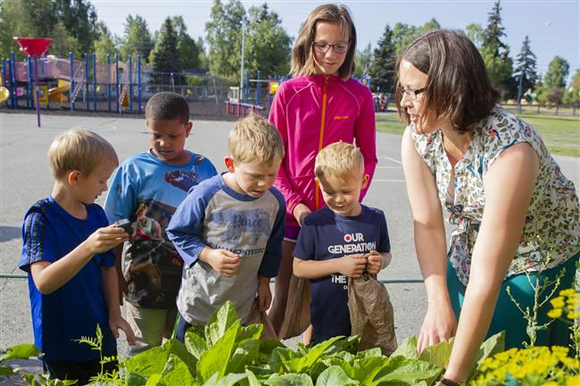 Jessica Sharp helps students garden