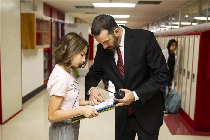 Central Middle School Assistant Principal helps a student
