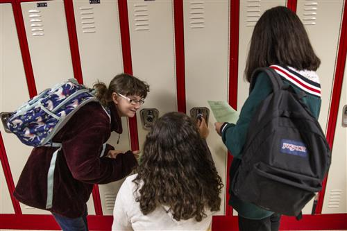 Students work on getting their lockers open on the first day of school