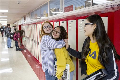 Students welcome each other on the first day of school at Central Middle School of Science