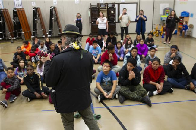 Alaska State Senator Tom Begich plays the ukulele for students at Fairview Elementary.