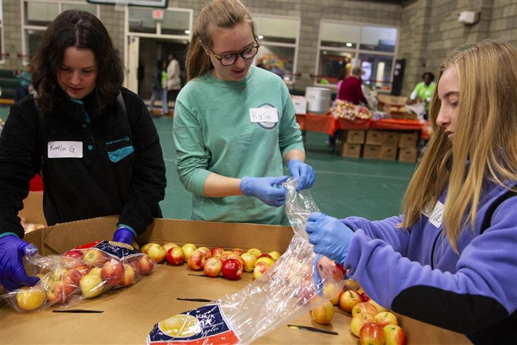 Students from Family Partnership Charter School sort apples at the Food Bank of Alaska's Thanksgiving Blessing