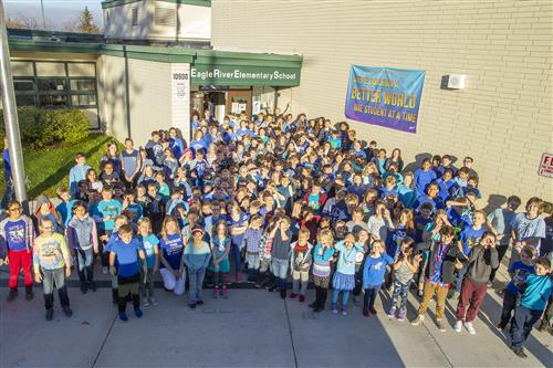 Eagle River Students posing for group photo in front of school