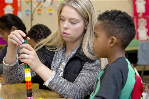 JoEllen Walters helps a student during math instruction.