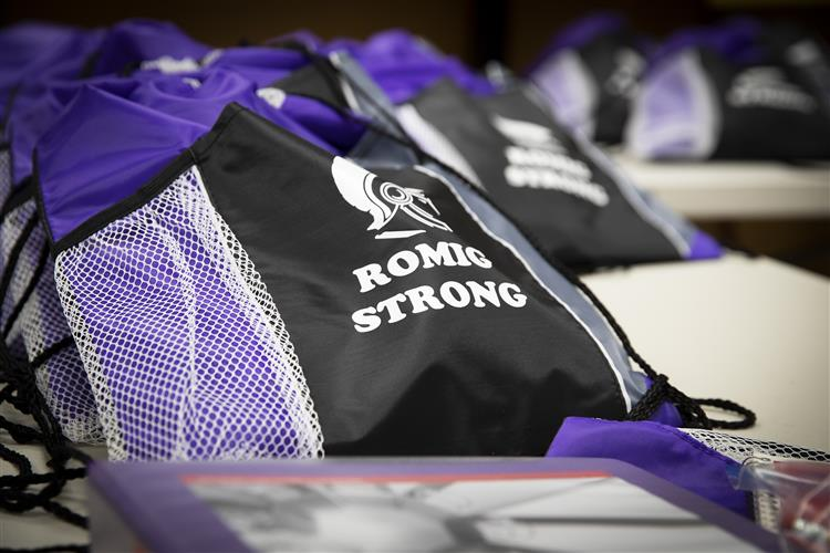 Romig Backpacks sit ready for distribution