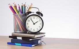 alarm clock, books, colored pencils
