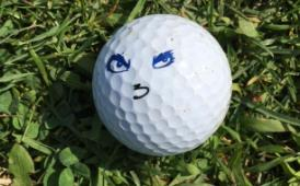 golf ball with smiley face