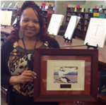 Mrs. Pinkney with library of the year award, 2016