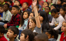 Student Raising Hand in assembly