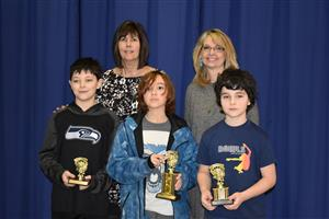 Spelling Bee winners with librarian and principal
