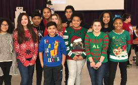 Romig students pose with their holiday sweaters in Dec. 2017