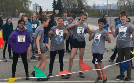 a teacher and student run together in the 2018 Romig triathlon