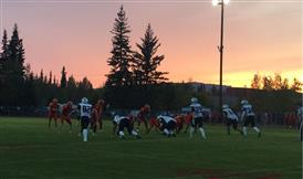 Football players in game against North Pole with beautiful sunset
