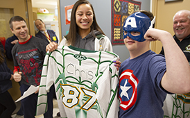 Service High School Partners Club and Hockey Team Join Forces to Raise Funds
