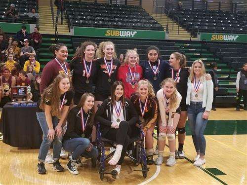 West volleyball students with medals
