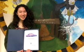 West student Natalie Fraser poses with her Spirit of Youth award certificate